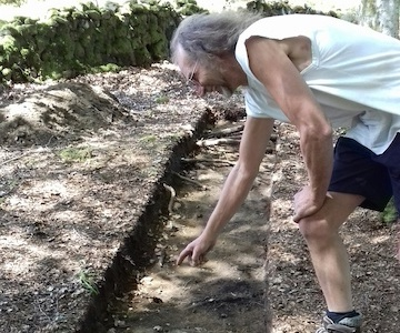 Volunteer Andrew Wainwright digging in one of the trenches